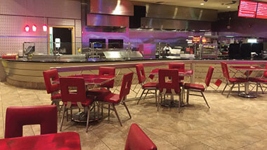 Red seats and tables inside Celebrity Grill at Hollywood Casino in St. Louis, Missouri.