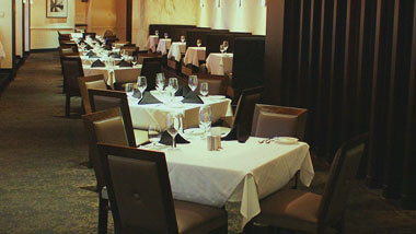 A row of four-top tables set for dinner inside of Final Cut Steakhouse at Hollywood Casino in St. Louis, Missouri.