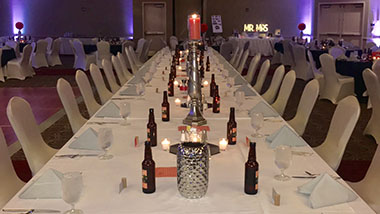 A family-style table setup for a wedding reception at Hollywood Casino St. Louis.