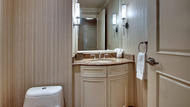 hotel bathroom with vanity and toilet