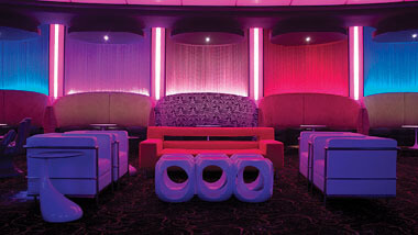 Multi-colored chairs and sofas inside Boogie Nights night club at Hollywood Casino in St. Louis, Missouri.